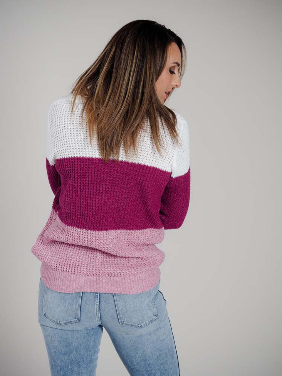 Lightweight loose knit sweater in soft bright white, magenta, and rose with long sleeves and crew neck