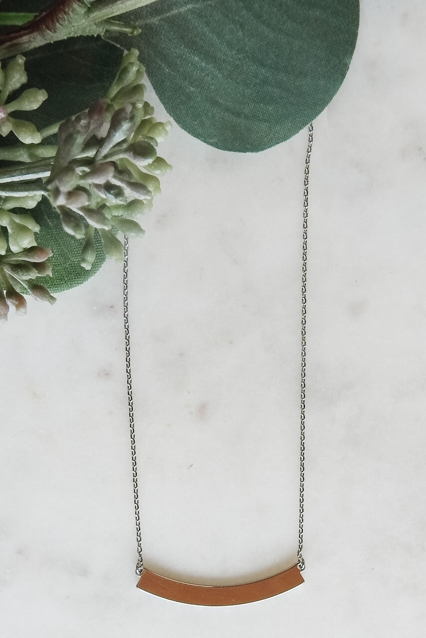 """White gold dipped necklace and 1 3/8"""" x 1/8"""" curved rectangle charm. Adjustable from 15.5"""" - 17.5"""" 16"""" with lobster claw clasp. Nickel and lead free."""