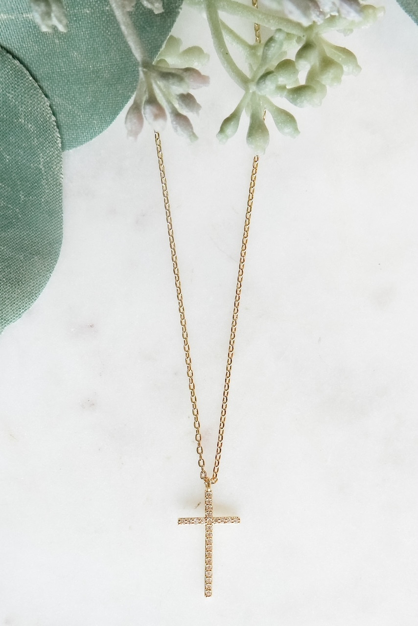 """Gold dipped dainty necklace with 1/2"""" x 3/4"""" CZ lined cross. Adjustable from 15.5"""" - 17.5"""" with lobster claw clasp. Nickel and lead free."""
