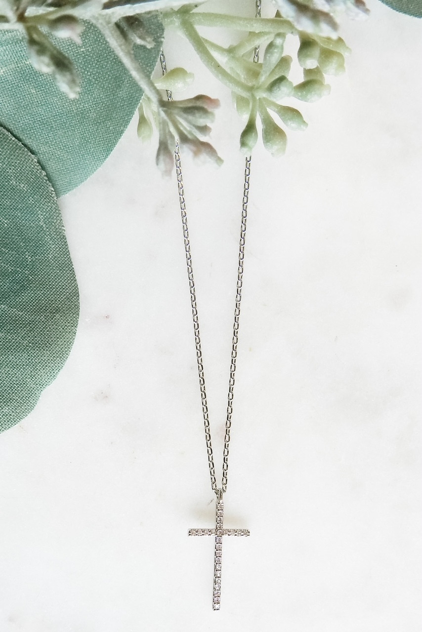 """White gold dipped dainty necklace with 1/2"""" x 3/4"""" CZ lined cross. Adjustable from 15.5"""" - 17.5"""" with lobster claw clasp. Nickel and lead free."""