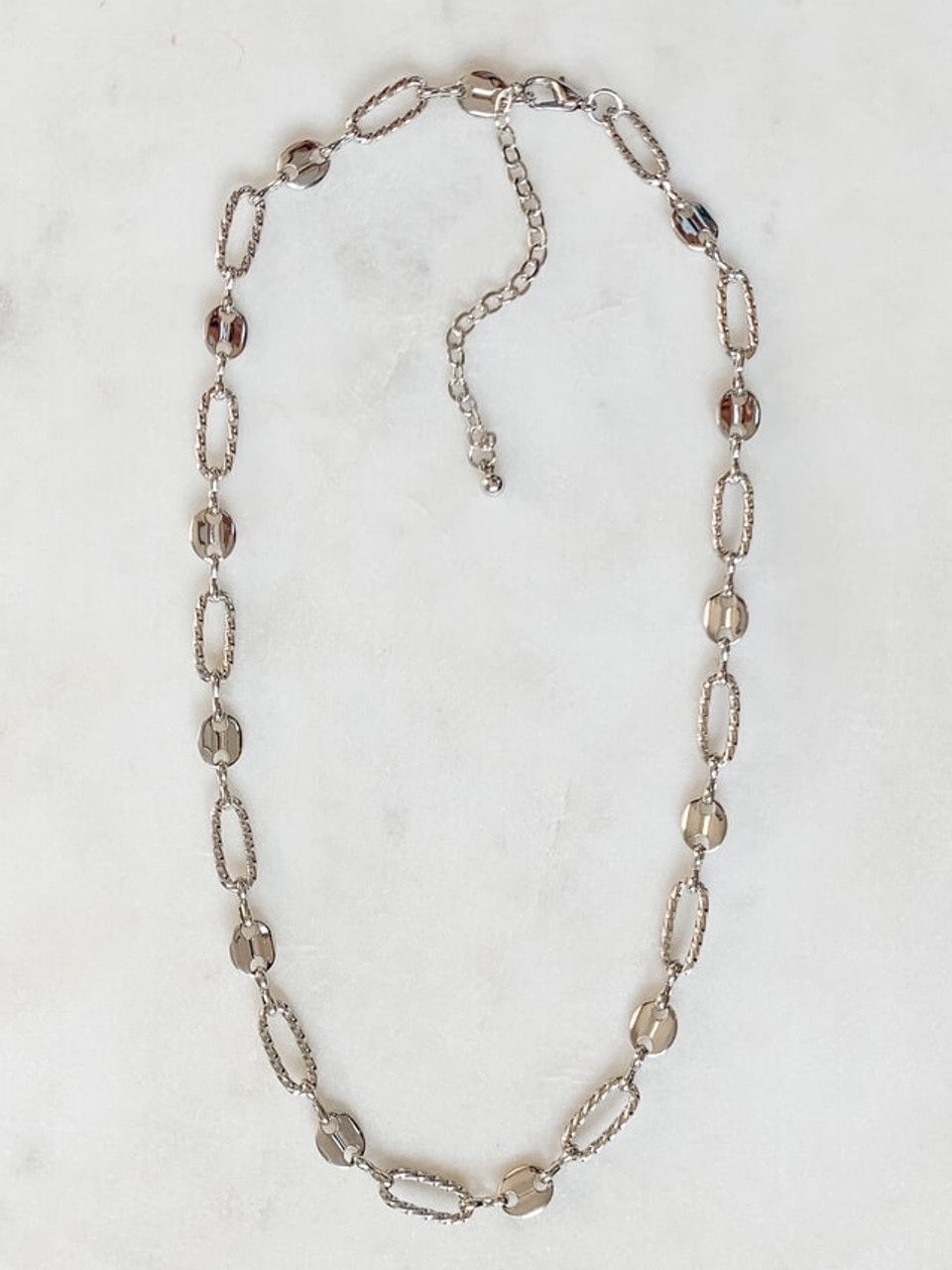 """Silver-tone twisted ovals links and oval button links connected with figure-eight links. Adjustable from 16"""" - 19 1/4""""; lobsterclaw clasp; nickel and lead free."""