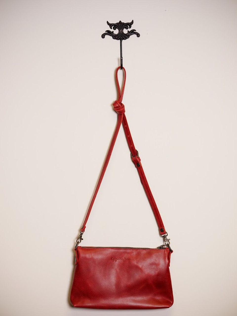 Shiny, Red Leather Purse Hangs on Antique Hook