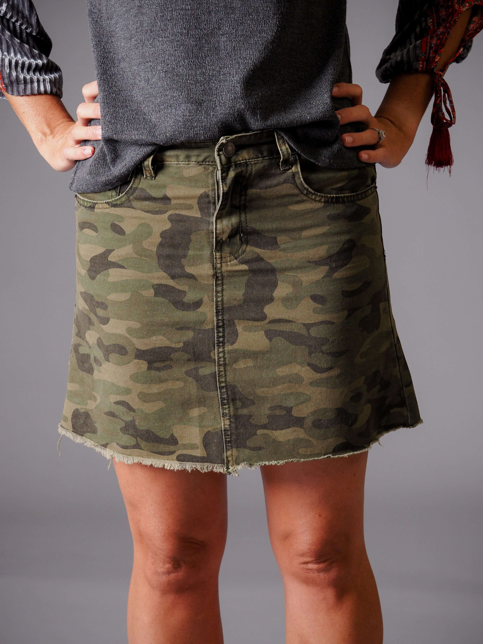 green camo print skirt with pockets and frayed edge