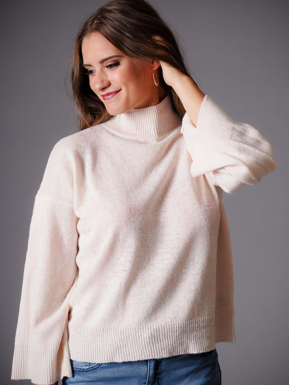 cream mock turtleneck sweater with pink confetti