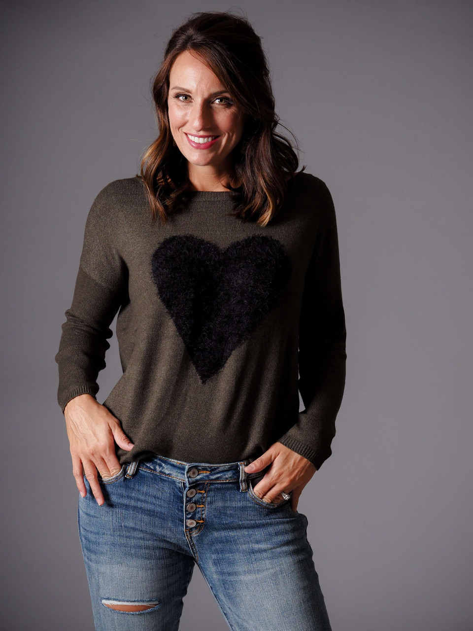 olive green crew neck sweater with black heart pattern