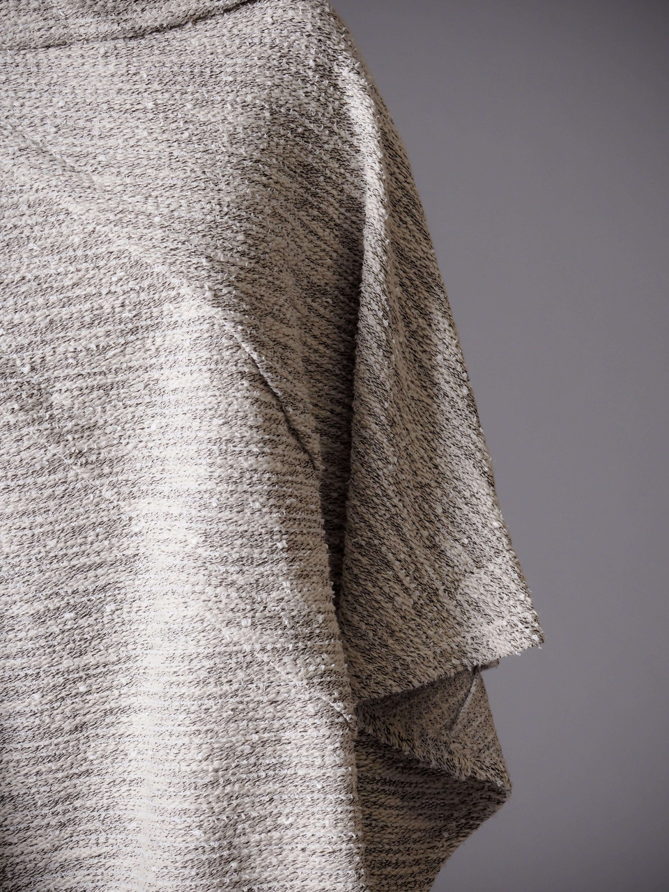 gray and white textured boat neck poncho