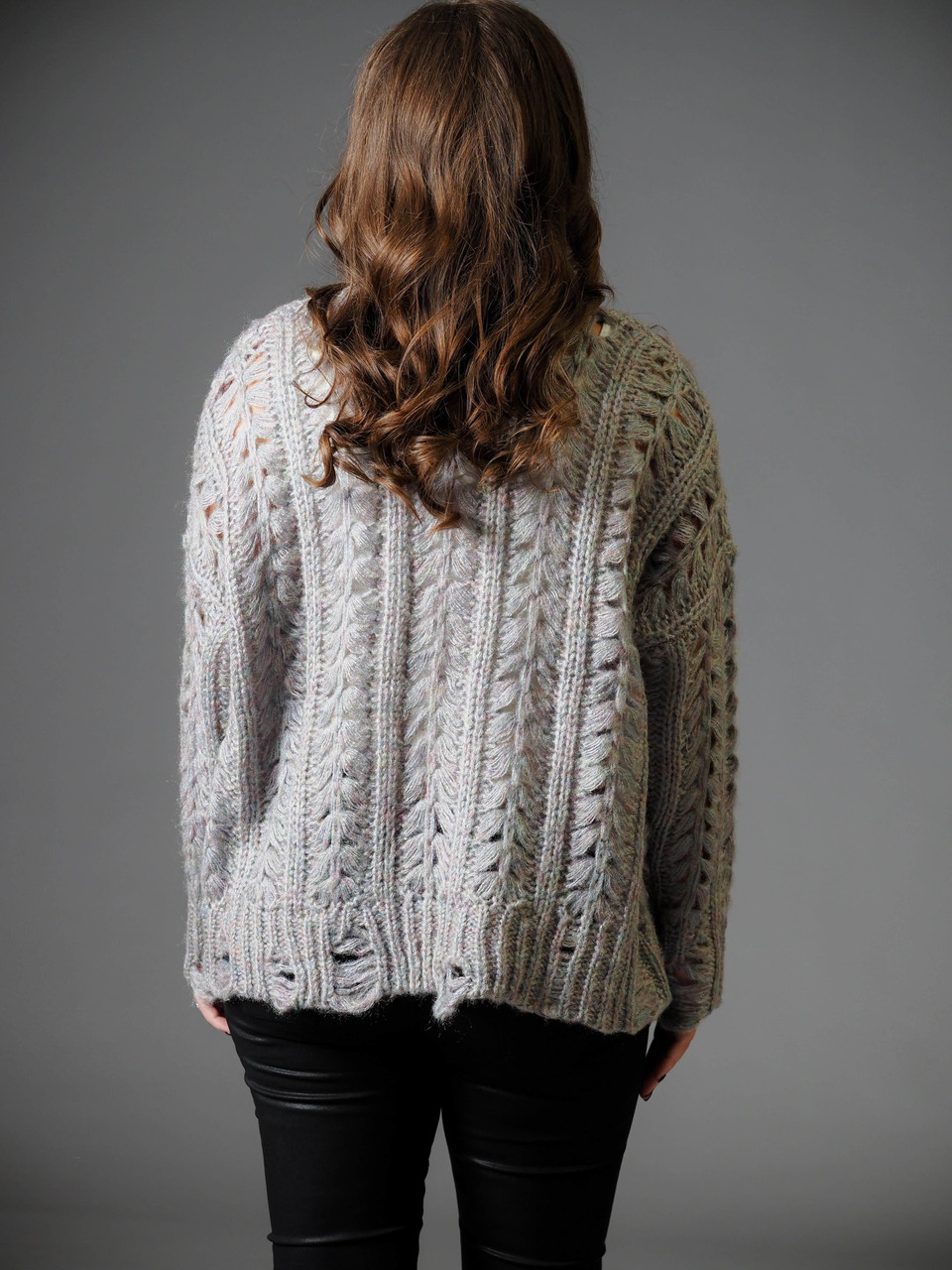 multi colored grey cable knit sweater