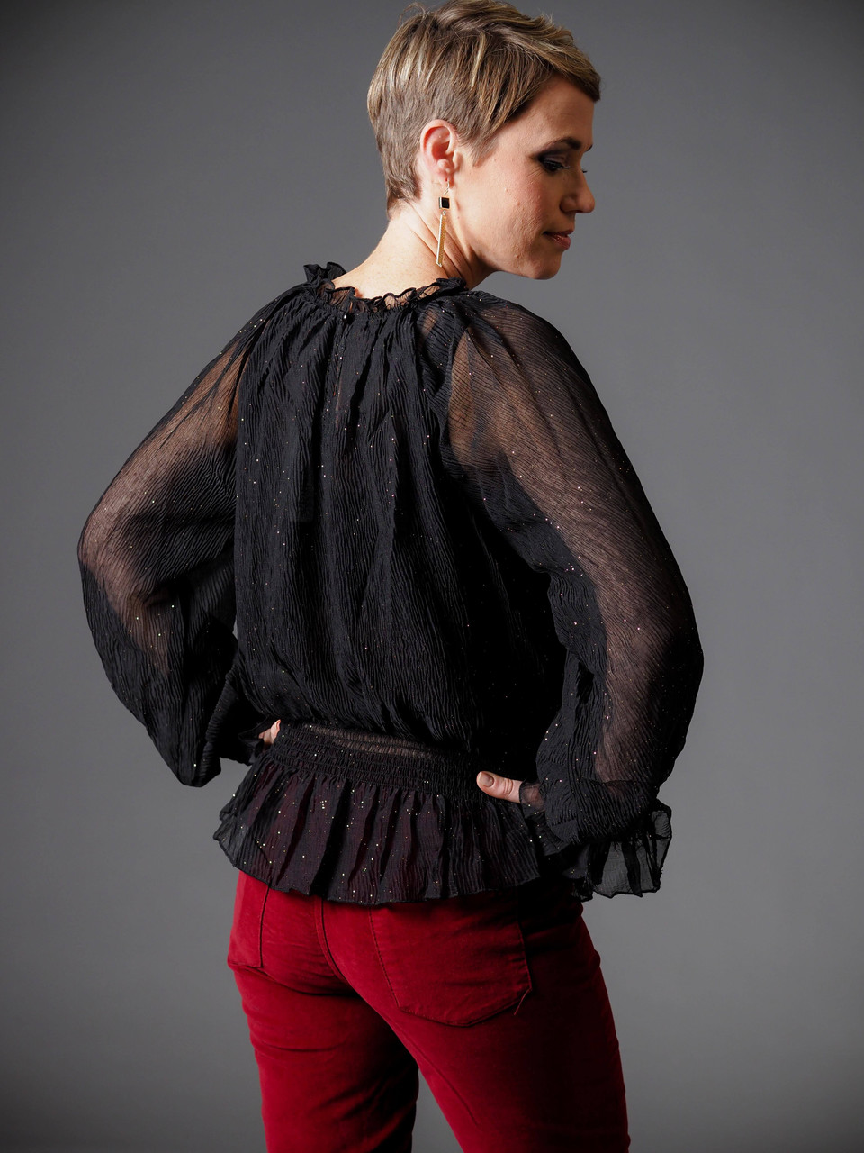 black sheer blouse with gold shimmer
