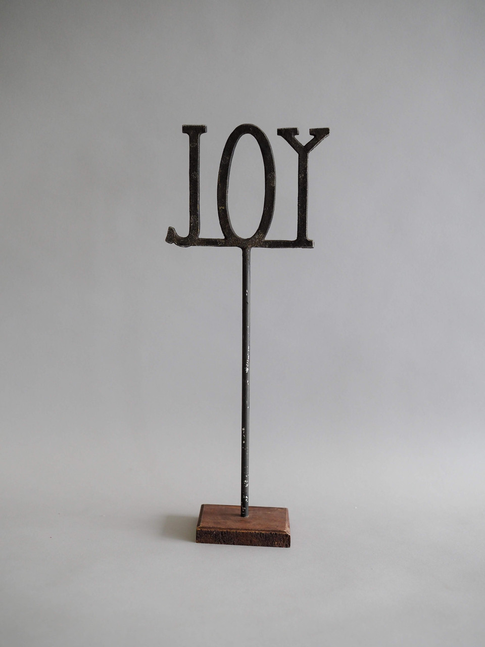 cast iron with wood base sentiment sitter