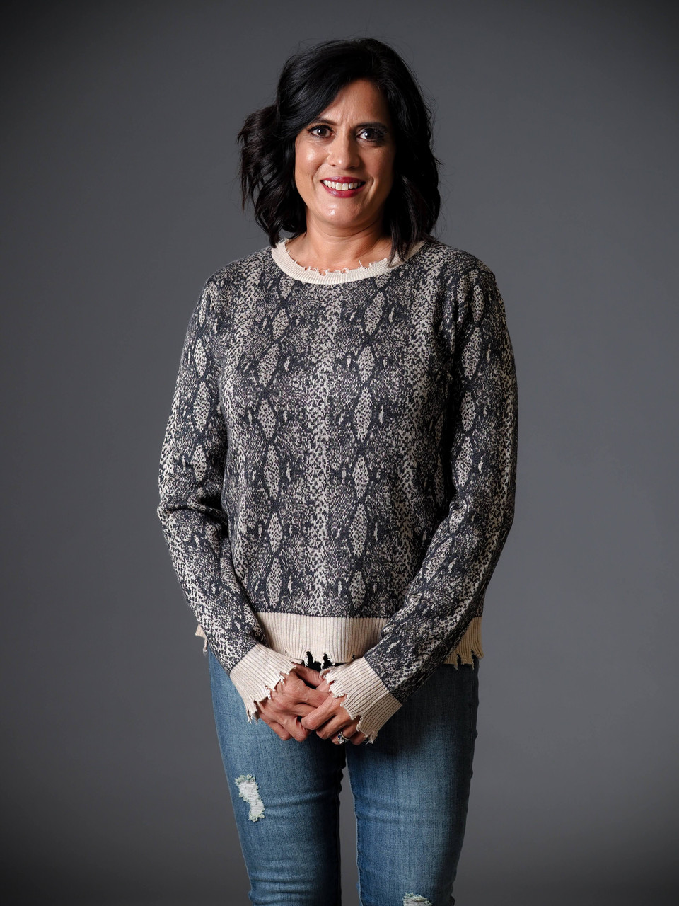 black and taupe distressed snake print sweater