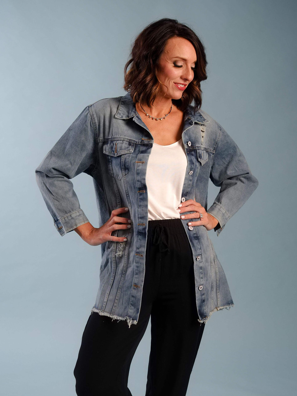 Oversized distressed light wash denim jacket