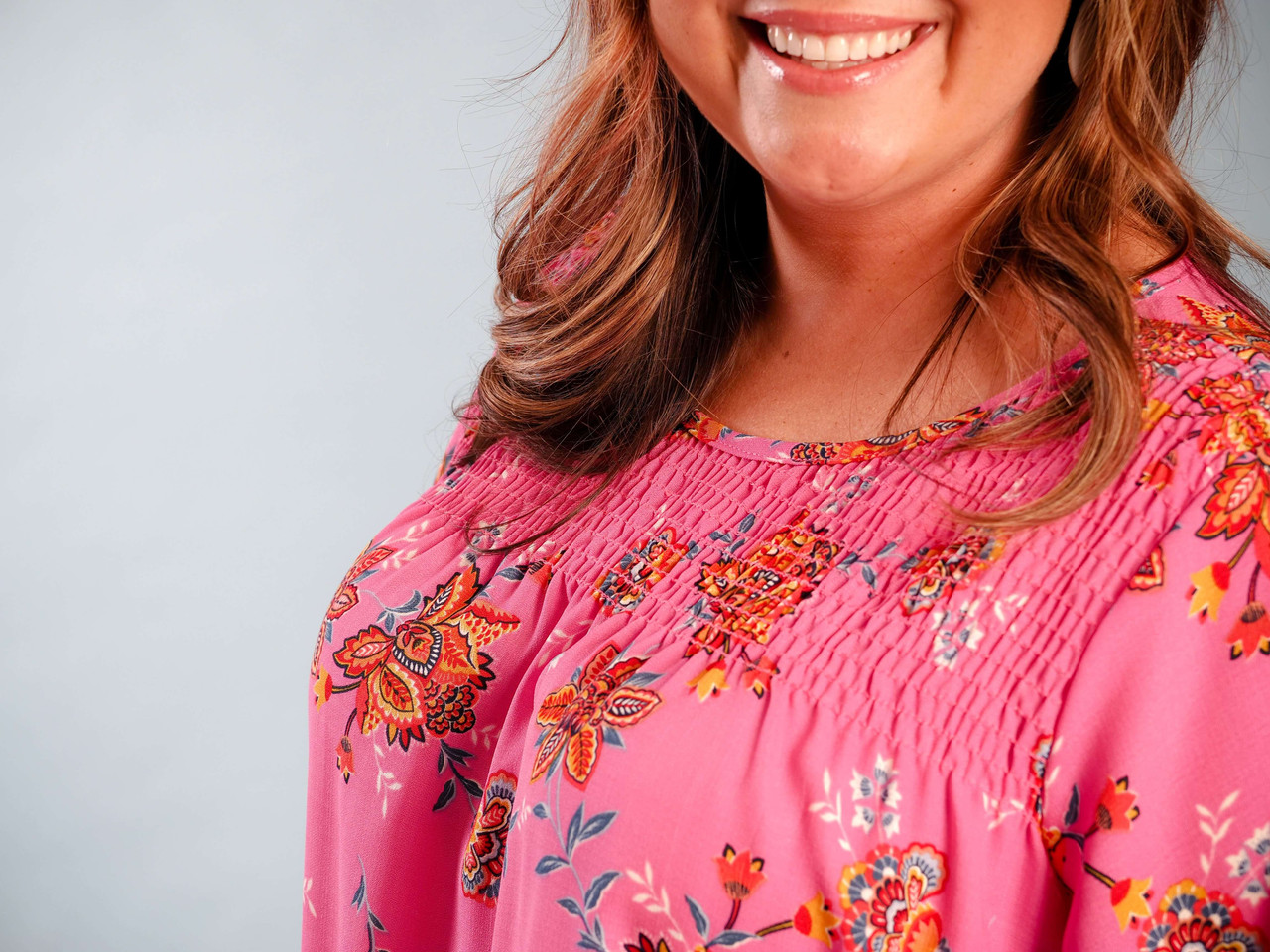pink blouse with floral detail smocked chest detail plus clothing curvy