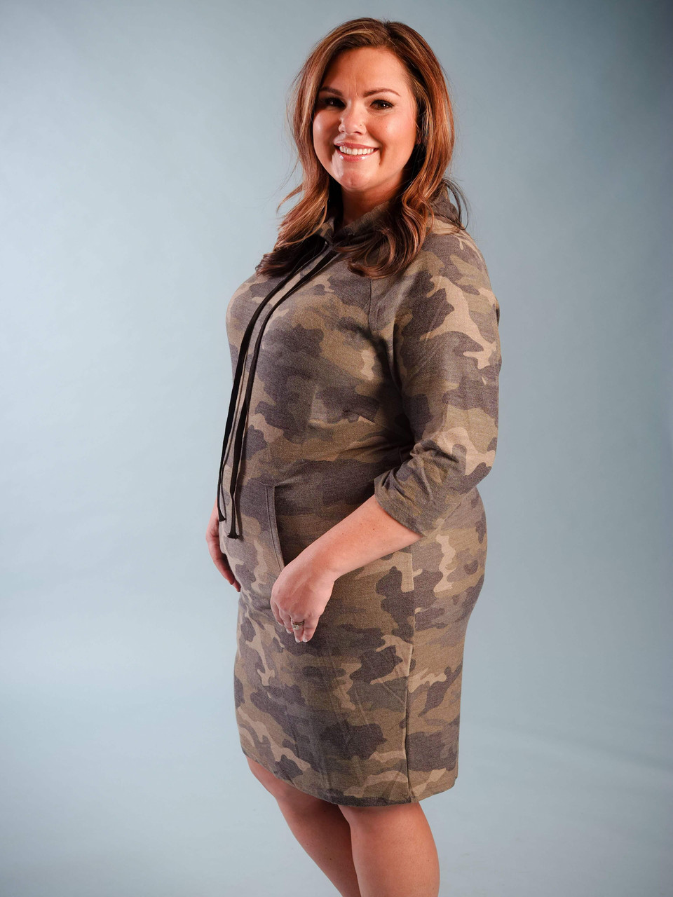 Soft lightweight hooded camo dress with drawstring, Front pockets, 3/4 length sleeve, Model is wearing a 2X.