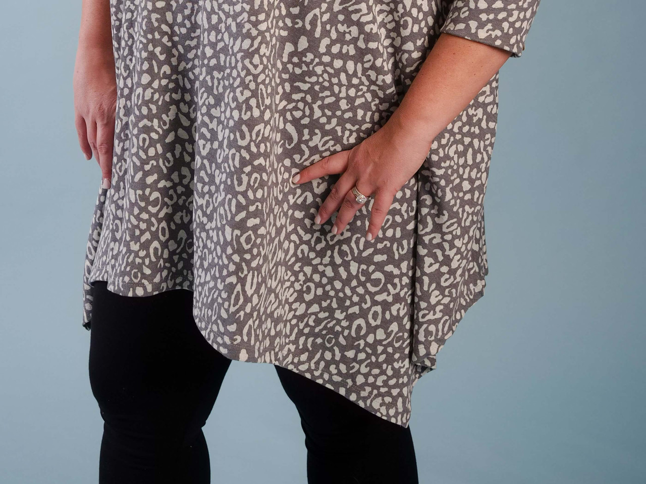 Lightweight jersey tunic, 3/4 sleeves, Bottom hem asymmetric detail, Model is wearing a size 1X/2X.