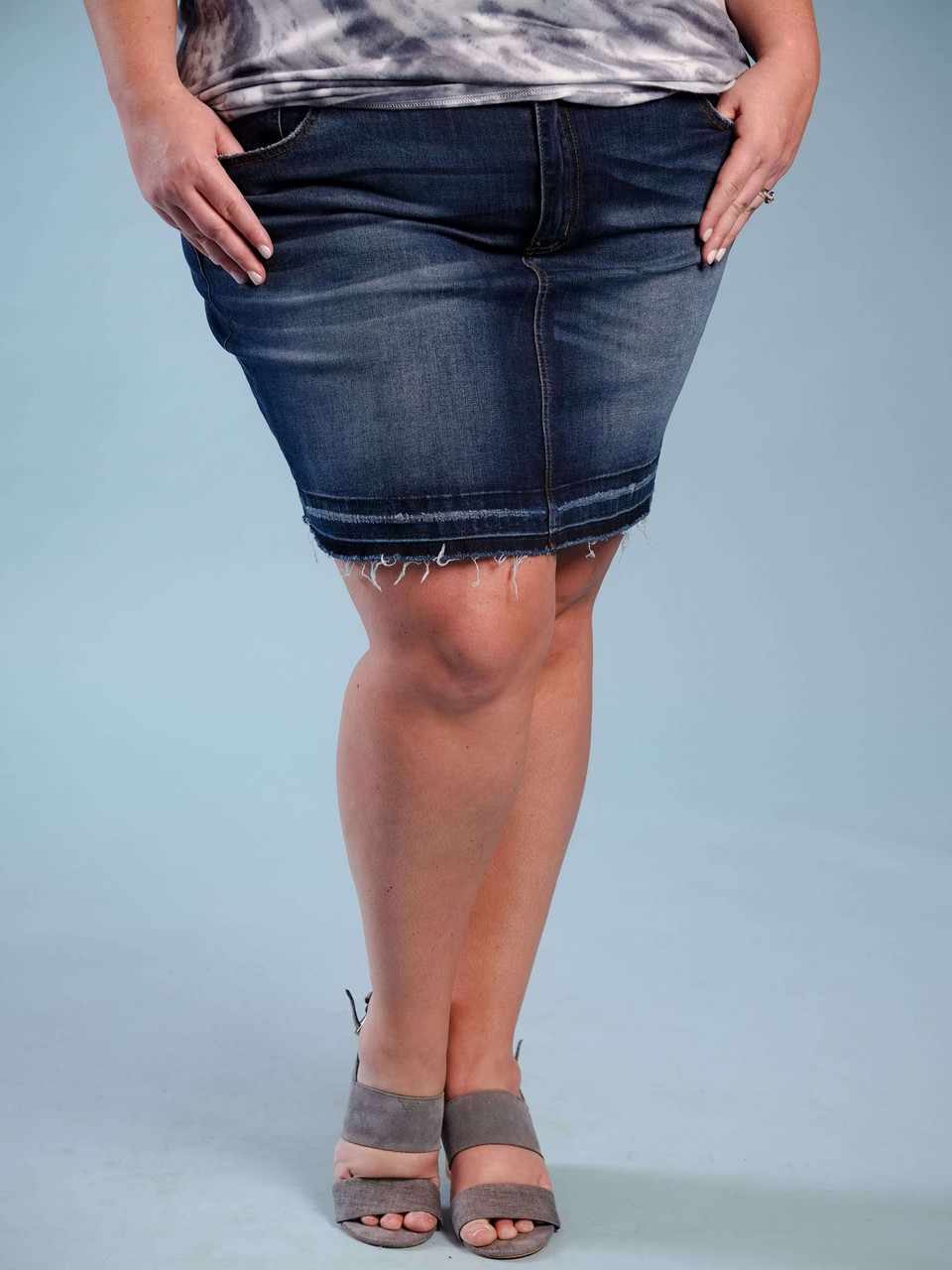dark denim skirt with frayed and distressed hem plus clothing curvy