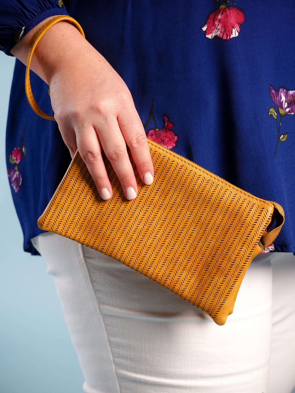 wristlet with adjustable crossbody strap lasercut yellow