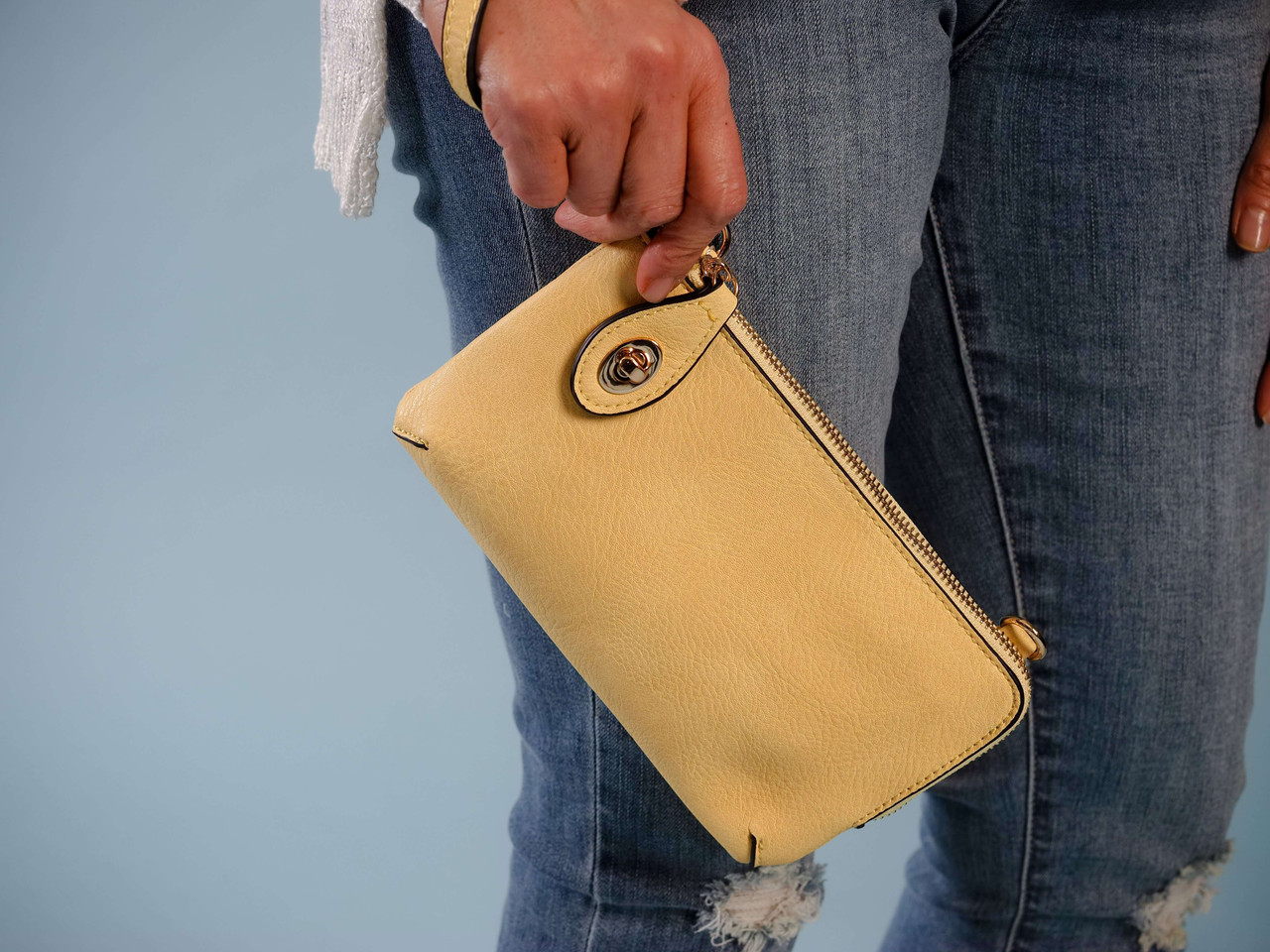 wristlet with adjustable crossbody strap with yellow