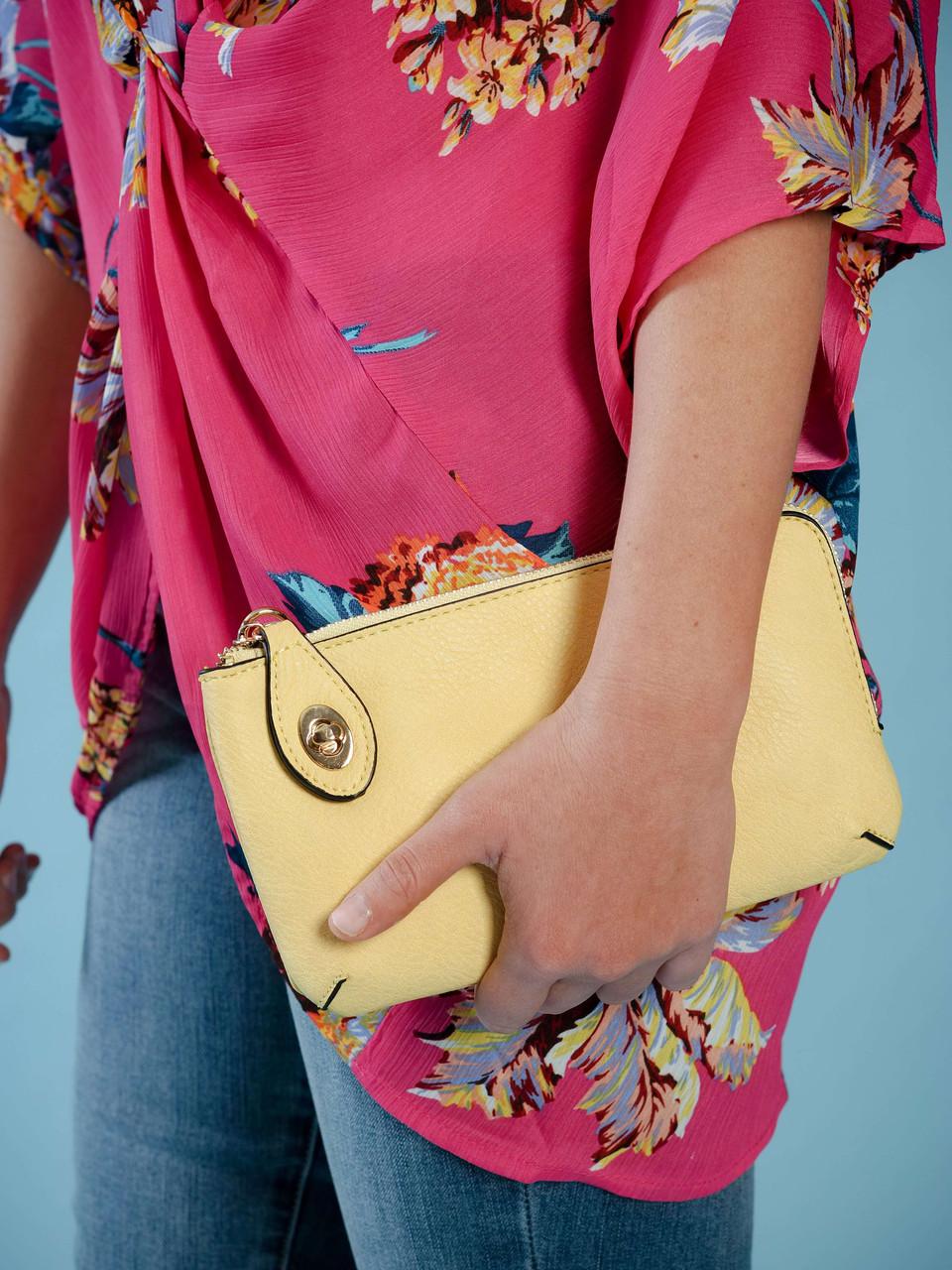 wristlet with adjustable crossbody strap yellow