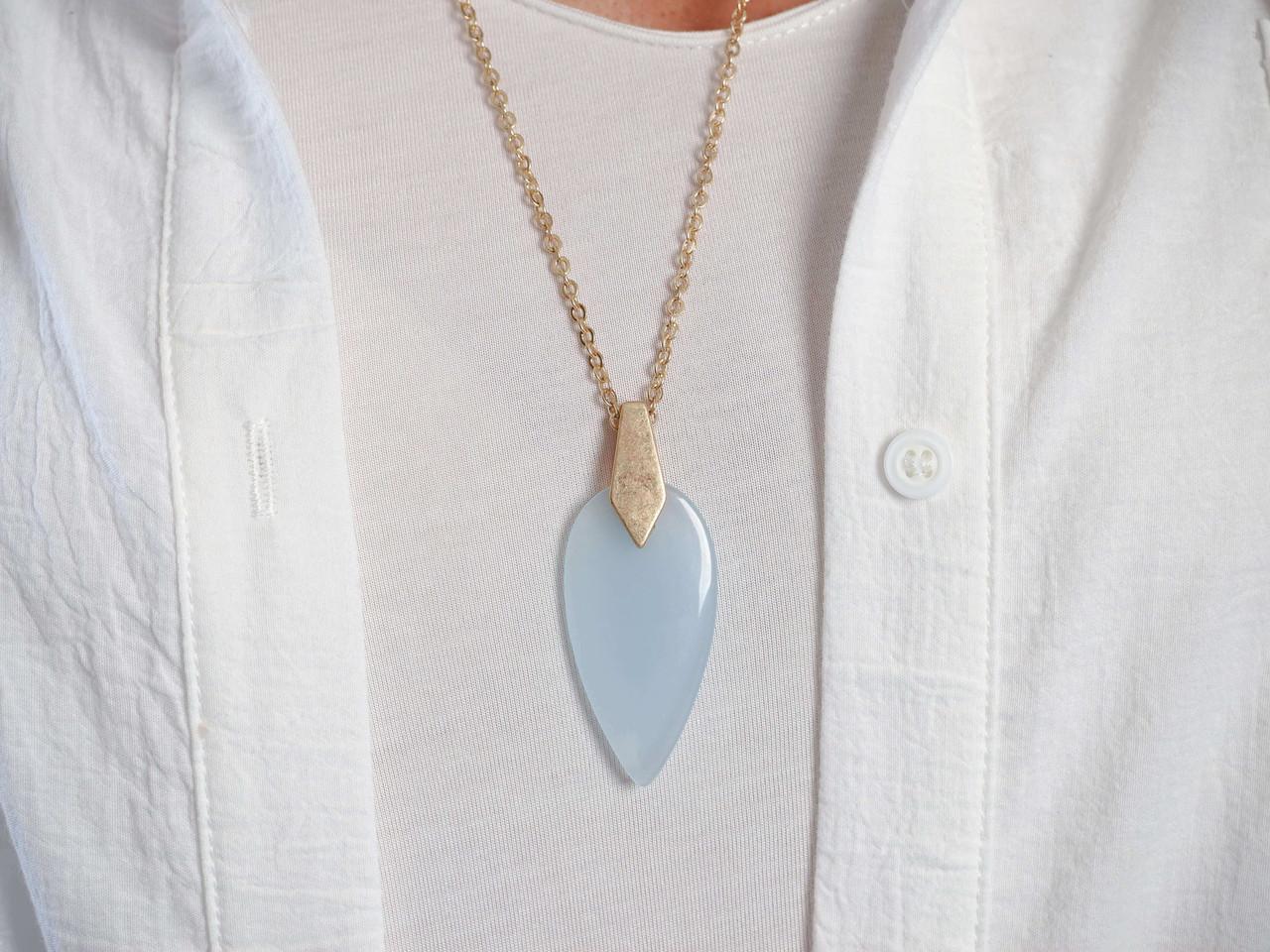 gold chain translucent blue pendant