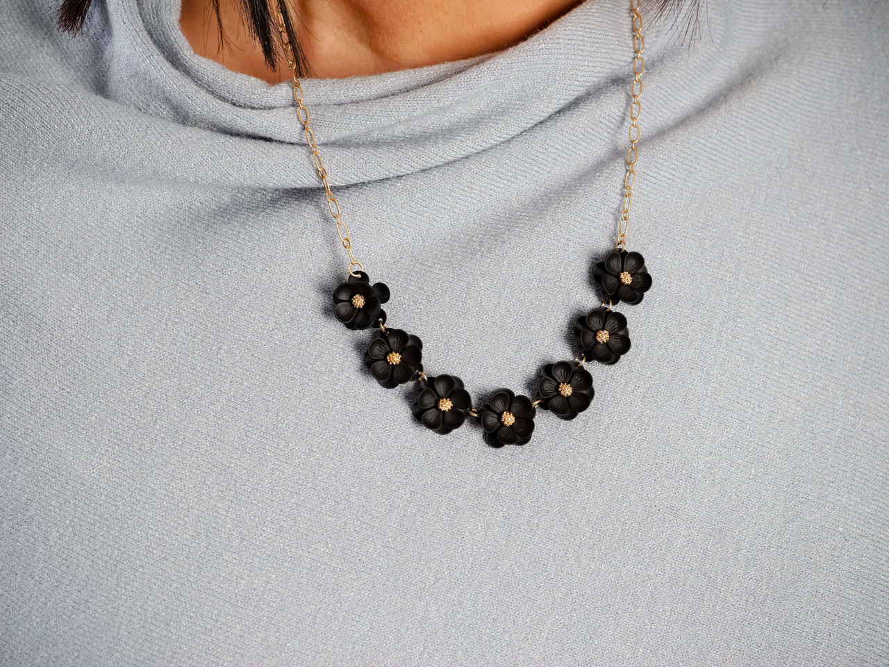 gold chain black flower accent