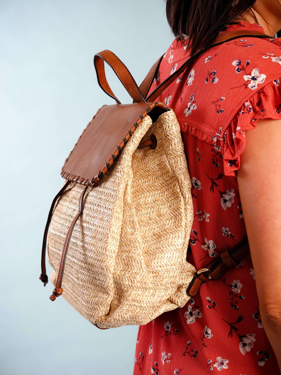 straw backpack faux leather accents