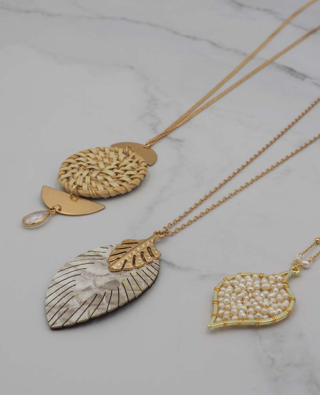 gold faux snake print feather necklace