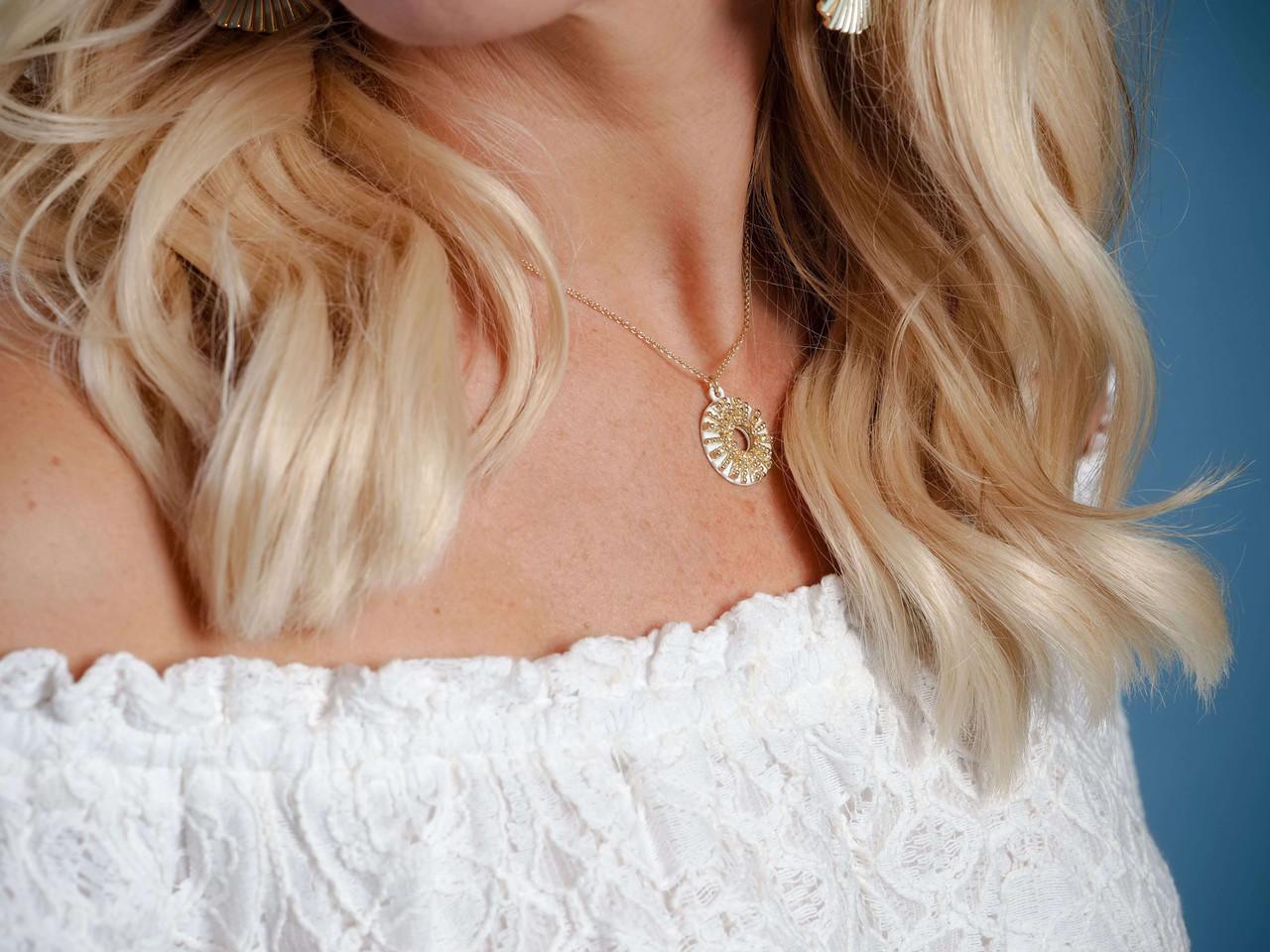 gold chain white sunburst pendant necklace