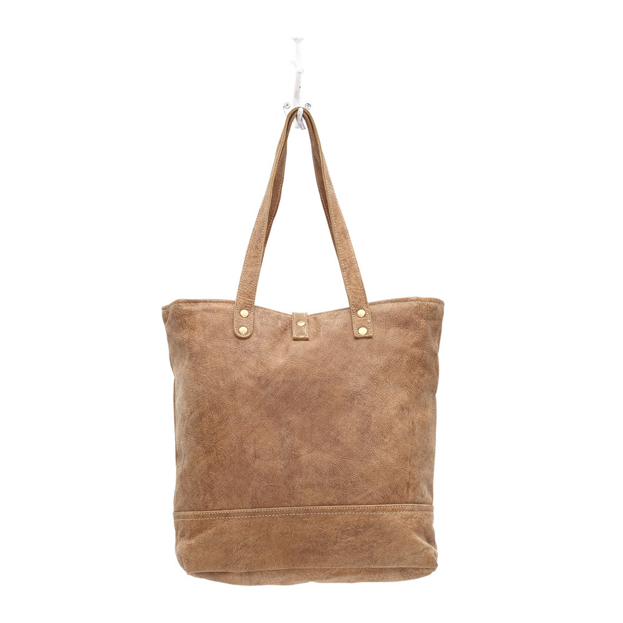 Large distressed leather tote with snap front detail and zipper closure. Interior has double open pockets and a single pocket with zipper.