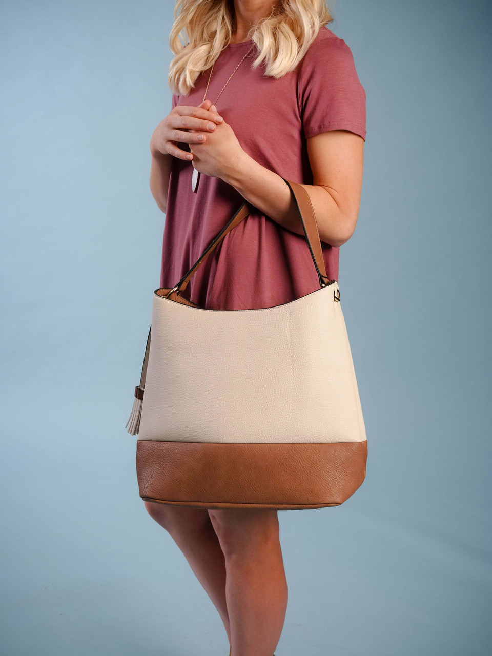 two toned vegan leather ivory and brown hobo bag