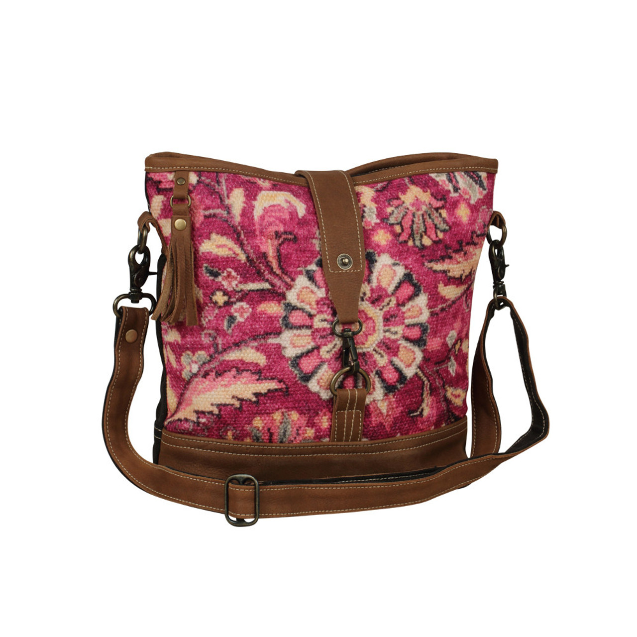 Leather, canvas & rug tote. The front has a vibrant pink floral rug print with a front clasp and main zipper closure. The back is solid canvas with a pocket and zipper. Interior has double open pockets and a single pocket with zipper.