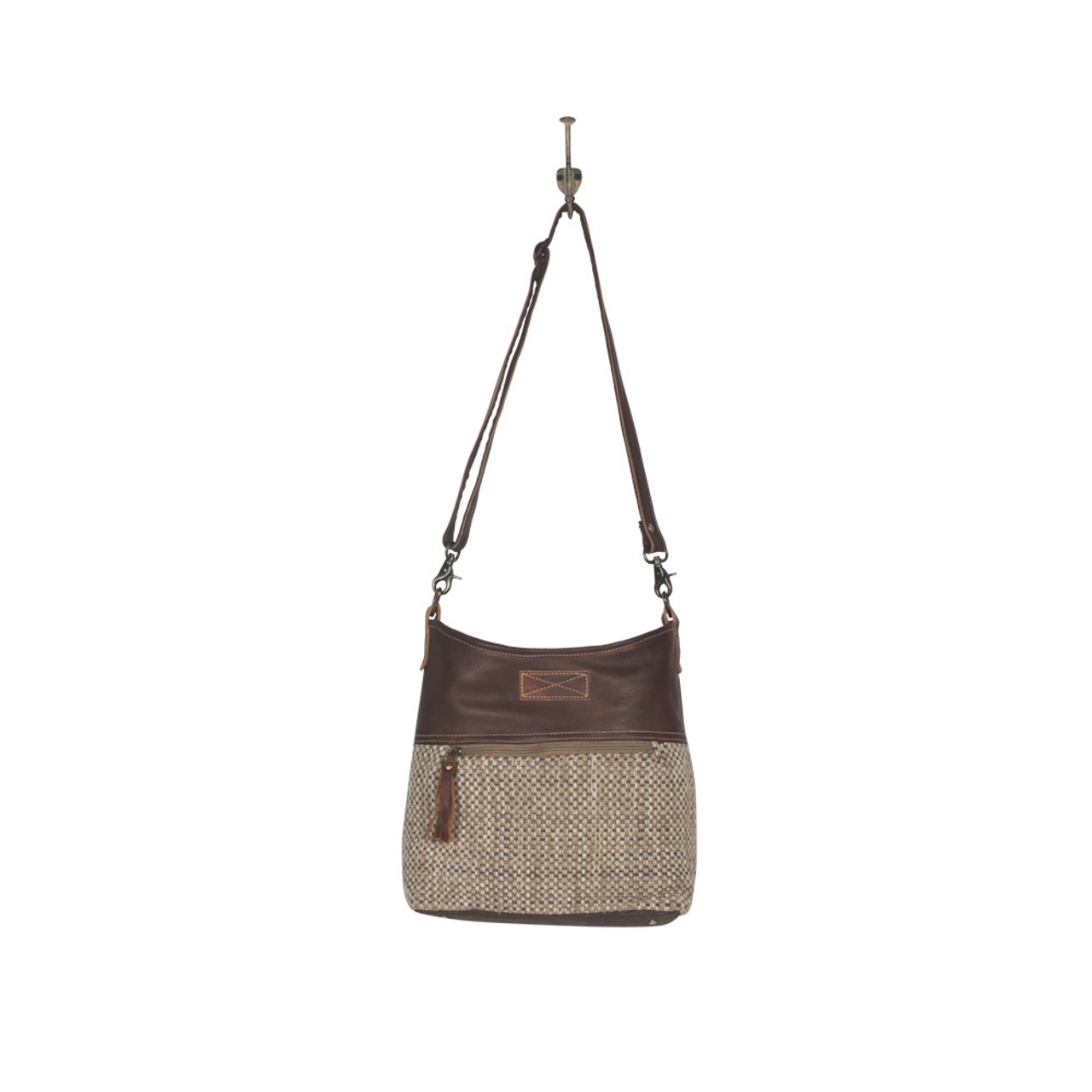 Leather, canvas & rug tote.  The front has a neutral woven pattern with main zipper closure and front pocket and zipper.  The back is solid canvas, also with a pocket and zipper.   Interior has double open pockets and a single pocket with zipper.