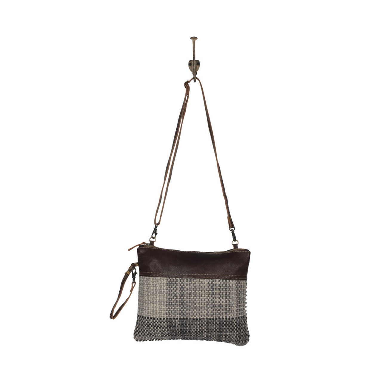 Leather, canvas & rug wristlet or crossbody.  The front has a neutral woven pattern with main zipper closure and the back is solid canvas.   No interior pockets.