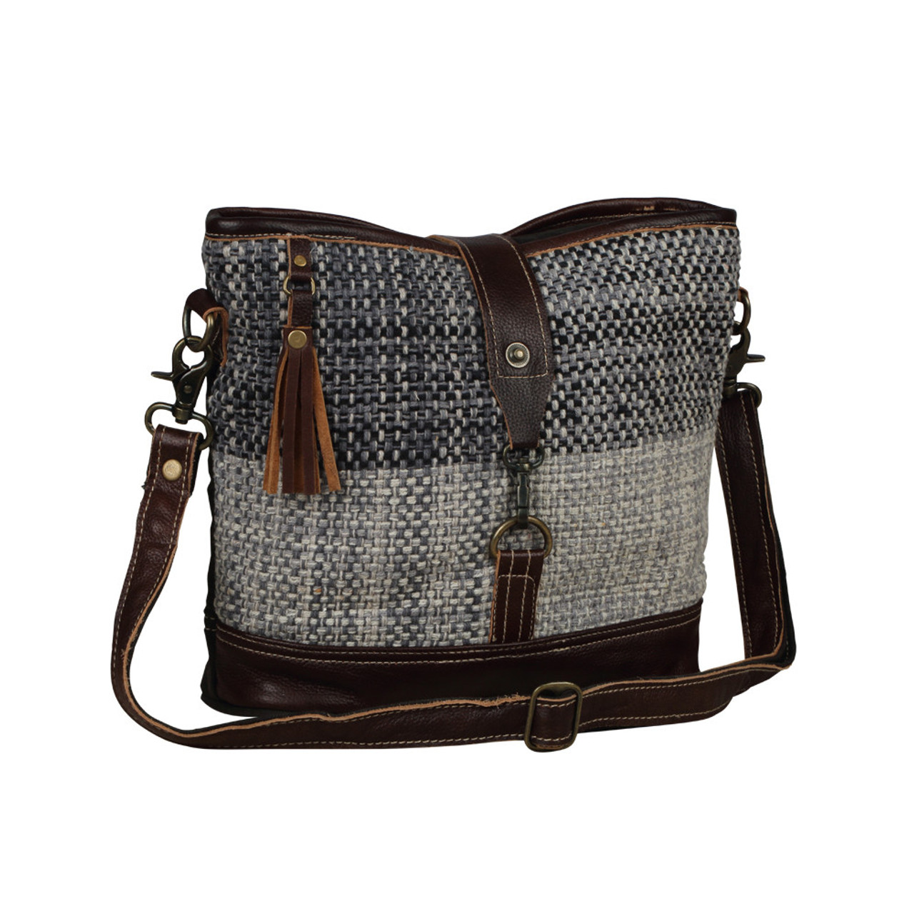 Leather, canvas & rug tote. The front has a neutral woven pattern with clasp and main zipper closure. The back is solid canvas with pocket and zipper. Interior has double open pockets and a single pocket with zipper.