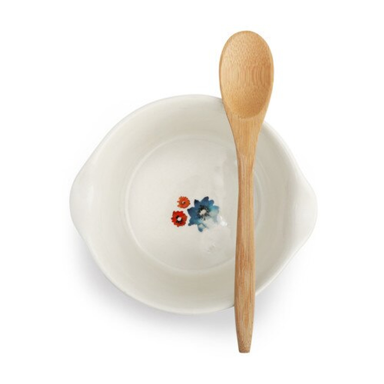 This hand-textured dish features an original floral design, ideal for kitchen decor. Any cook or baking enthusiast will enjoy this unique ceramic bowl. It's great for appetizer serving or baking, standing up to 400 degrees of oven heat.