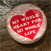 "This classic paperweight features a red heart with the phrase ""My whole heart for my whole life"" written on the inside."
