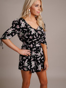 Blonde Woman Models Black and White Floral Romper
