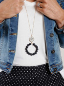 gold necklace with snakeprint and black beads