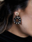 black leather and gold earring