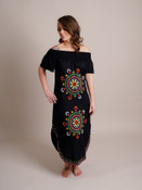 Woman Models Black Maxi Dress With Bright, Multicolored Embroidery
