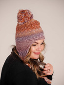 multicolor hat with braided tassels and pom pom