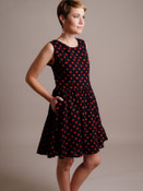 Woman Models a Black and Red Polka Dot Sleeveless Dress