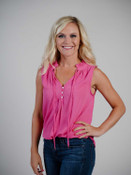 pink sleeveless top with ruffle neck detail