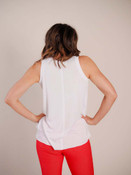 Bright red jeggings with front and back pockets and decorative button at top of faux-fly
