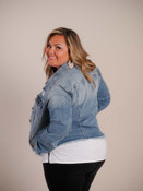 Essential medium/light blue denim jacket with frayed details. Pointed fold-over colar, 6 buttons down front, buttoned flap pockets on front above tapering seams, slit pockets on sides, long sleeves with button closure at wrists, classic