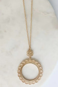 """gold Flower pendant with a thread wrapped lace look on a long necklace. Adjustable from 30"""" to 33"""".Nickel and lead free."""