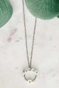 """Dainty circle charm with pearly and shimmery seed and flower beads. Adjustable chain from 16.5""""-19.5"""" with lobsterclaw clasp. Includes dainty silver tone hook earrings with a sparkle cut milky white bead on each; .5"""" drop. Nickel and lead free."""