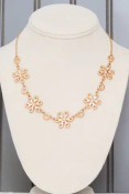 """Gold thread wrapped lace look on alternating flower and circle charms. Adjustable from 16.5""""-19.5"""" with lobsterclaw clasp. Flowers are approx. 3/4"""". Nickel and lead free."""