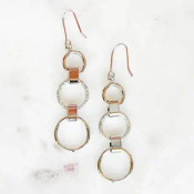 """Top and bottom circles are shiny and the middle circle is cut to sparkle! These white-gold dipped brass earrings dangle 2 3/8"""" from their hooks"""