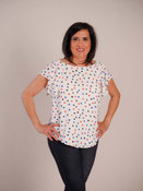 This blouse would be perfect for a dinner cruise or a party by the pool. Wide round neck, butterfly sleeves, bow close in back; lining layer in front