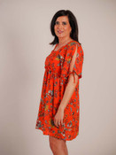 Redish orange floral dress with metalic thread detail. Wide box neck, short cold-shoulder sleeves with tie detail, high waist with ruffle detail in front, tie close with golden end detail in back, keyhole opening at mid-back